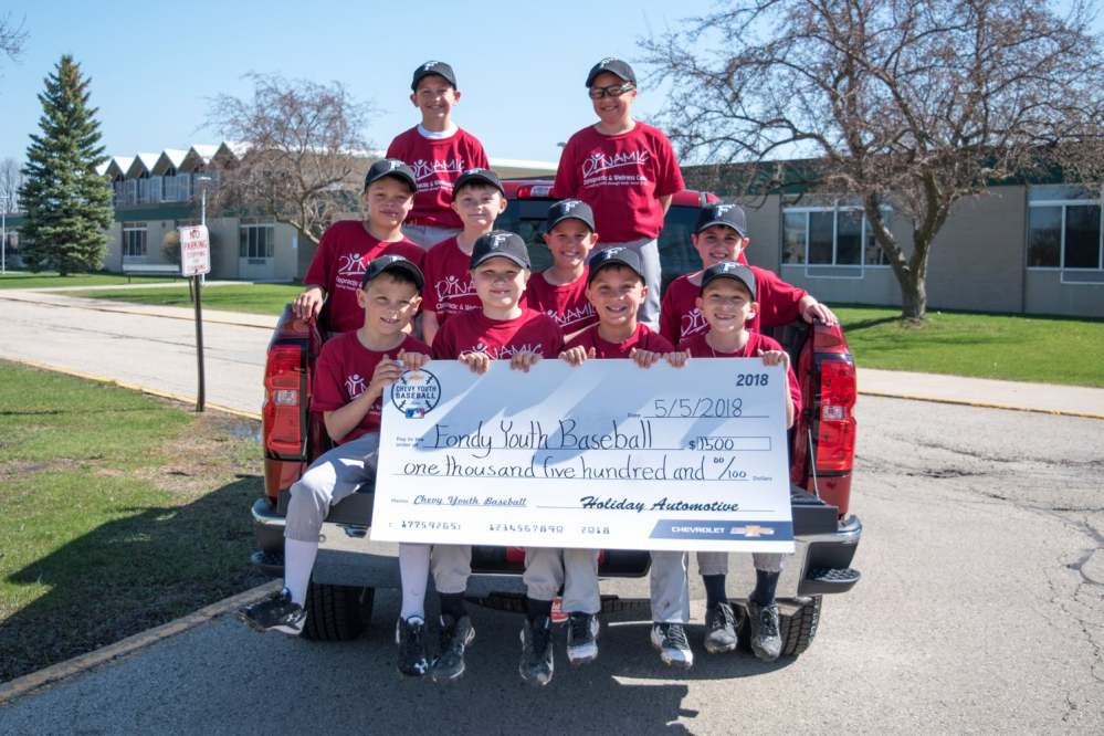 Local youth baseball team accepts check on behalf of Fondy Youth Baseball.