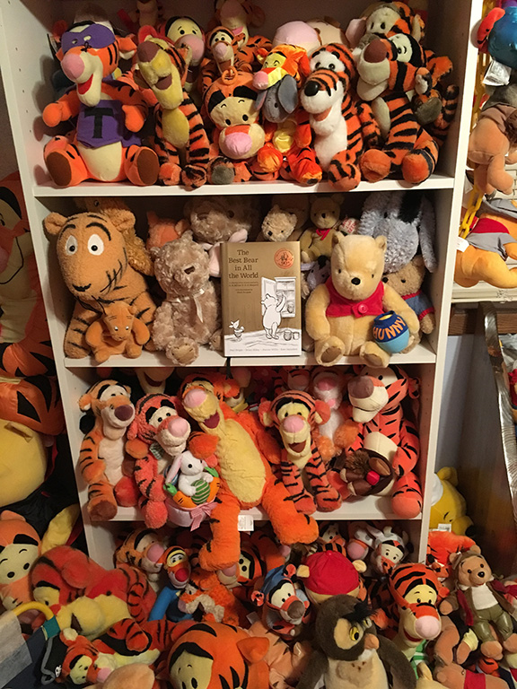 Shelf of plush Poohs in Deb Hoffmann's collection