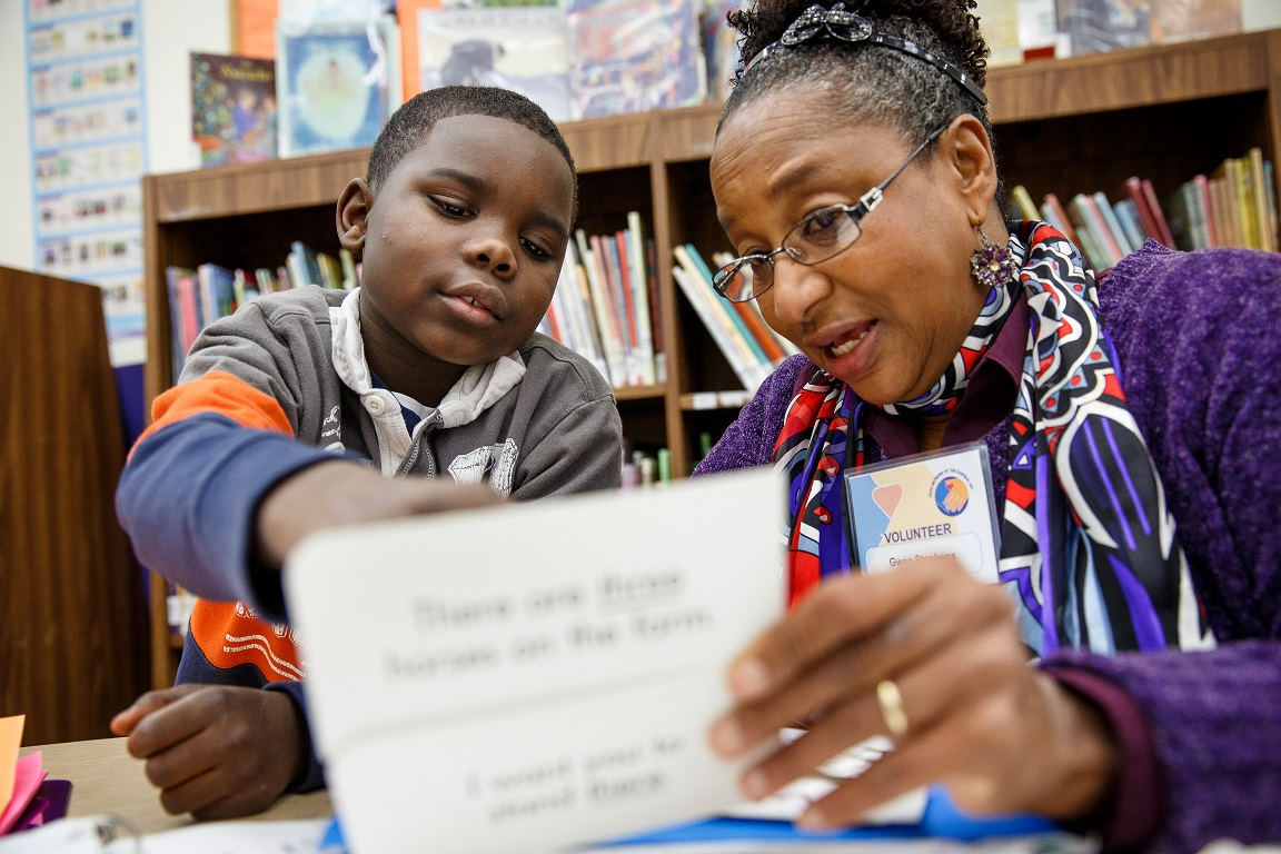 Trained and supported volunteer tutors help students with reading and math.